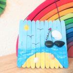 Sommerbild aus Muscheln und Eisstielen – Basteln mit Kindern